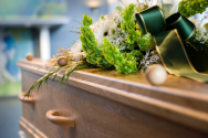 Casket with flowers on top